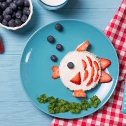 toast in a shape of fish sandwich with fruit elements