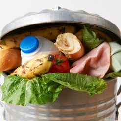 a bin overflowing with food waste